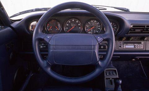 Motor vehicle, Mode of transport, Steering part, Transport, Steering wheel, Automotive design, Speedometer, White, Car, Gauge,