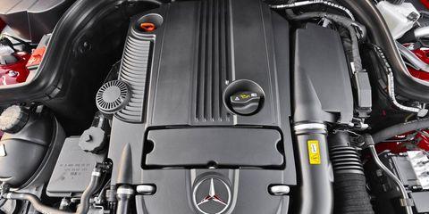 Automotive design, Motorcycle accessories, Luxury vehicle, Engine, Motorcycle, Personal luxury car, Carbon, Automotive engine part, Kit car, Muffler,