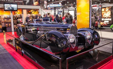 Automotive design, Auto show, Logo, Exhibition, Classic car, Auto part, Luxury vehicle, Classic, Antique car, Personal luxury car,