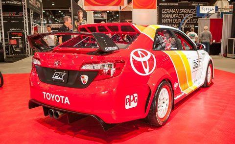 Automotive design, Vehicle, Event, Red, Car, Vehicle registration plate, Logo, Mid-size car, Alloy wheel, Auto show,