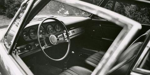 Motor vehicle, Steering part, Steering wheel, Vehicle, Vehicle door, Classic car, Glass, Car seat, Center console, Gauge,