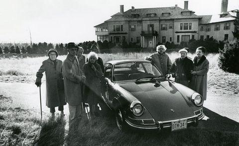 People, Window, Car, House, Classic car, Personal luxury car, Luxury vehicle, Alloy wheel, Classic, Windshield,