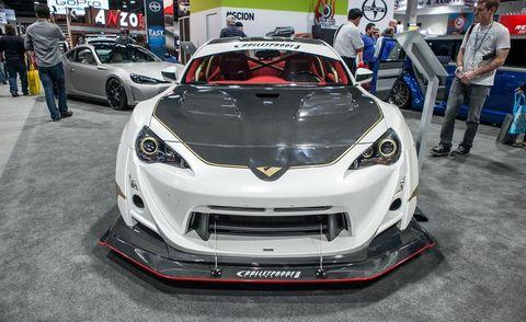 Automotive design, Vehicle, Event, Land vehicle, Car, Personal luxury car, Supercar, Automotive lighting, Auto show, Bumper,