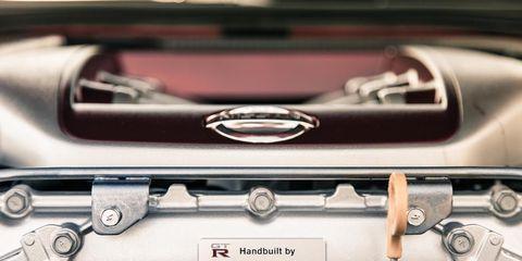 Motor vehicle, Automotive design, Automotive exterior, Logo, Metal, Personal luxury car, Design, Luxury vehicle, Machine, Emblem,