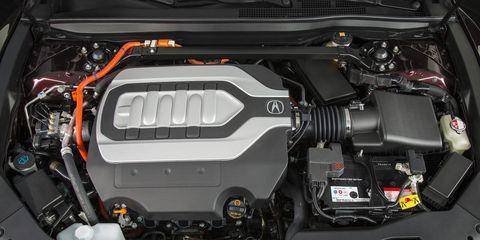 Automotive design, Engine, Automotive engine part, Bumper, Machine, Luxury vehicle, Automotive super charger part, Automotive air manifold, Personal luxury car, Kit car,