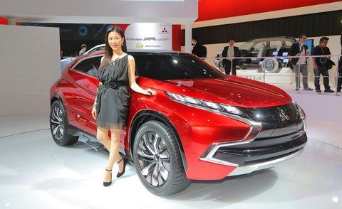 Automotive design, Vehicle, Event, Land vehicle, Car, Auto show, Exhibition, Automotive lighting, Dress, Fashion,