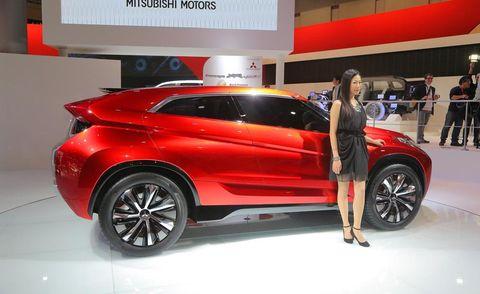 Tire, Wheel, Automotive design, Vehicle, Event, Land vehicle, Car, Red, Auto show, Exhibition,