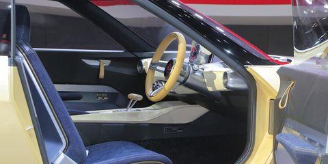 Motor vehicle, Mode of transport, Automotive design, Steering part, Yellow, Steering wheel, Vehicle door, Car seat, Car seat cover, Fixture,