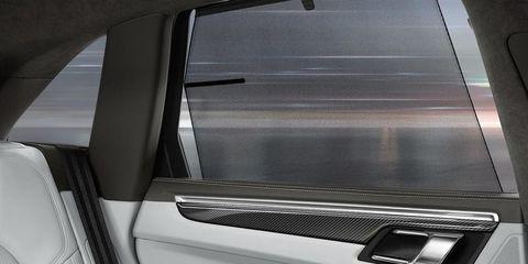 Automotive exterior, Automotive design, Vehicle door, Fixture, Automotive door part, Luxury vehicle, Automotive window part, Door handle, Silver, Personal luxury car,
