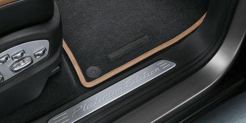 Motor vehicle, Automotive design, Vehicle door, Automotive exterior, Fixture, Automotive door part, Luxury vehicle, Leather, Silver, Personal luxury car,