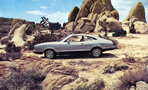 Tire, Wheel, Car, Rock, Bedrock, Alloy wheel, Outcrop, Classic car, Performance car, Hood,