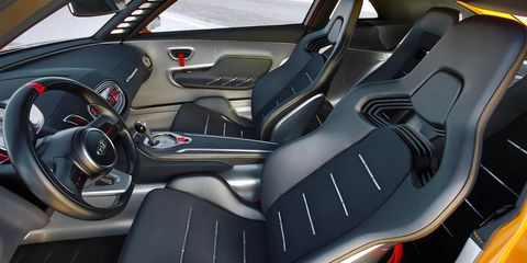 Motor vehicle, Mode of transport, Automotive design, Vehicle, Steering part, Steering wheel, Red, Car seat, Car seat cover, Carmine,