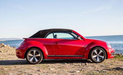 Wheel, Tire, Automotive design, Vehicle, Coastal and oceanic landforms, Automotive exterior, Car, Alloy wheel, Landscape, Red,