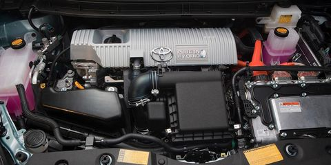 Engine, Automotive engine part, Stuffed toy, Technology, Automotive air manifold, Teddy bear, Toy, Automotive super charger part, Machine, Fuel line,