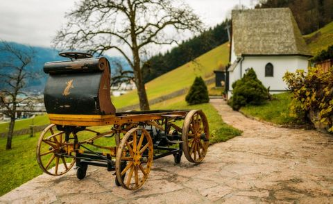 Tree, Rural area, House, Cart, Land lot, Spoke, Wagon, Carriage, Cottage, Human settlement,