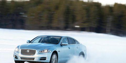 Tire, Automotive design, Winter, Transport, Car, Grille, Full-size car, Snow, Automotive mirror, Mid-size car,