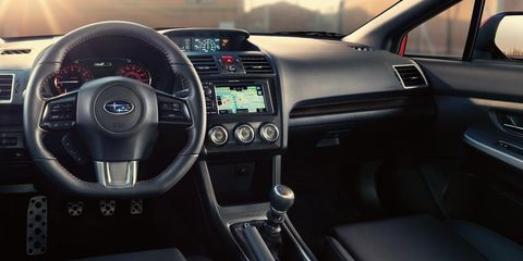 Motor vehicle, Steering part, Automotive design, Product, Steering wheel, Center console, White, Technology, Car, Speedometer,
