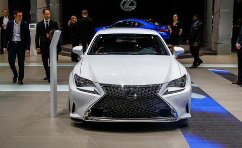 Automotive design, Vehicle, Event, Land vehicle, Car, Exhibition, Suit, Luxury vehicle, Auto show, Grille,