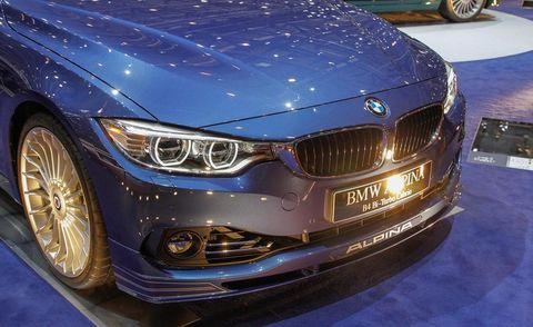 Automotive design, Blue, Mode of transport, Vehicle, Automotive exterior, Hood, Grille, Car, Automotive lighting, Vehicle registration plate,
