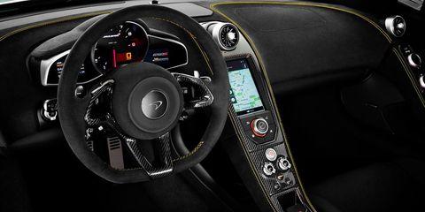 Motor vehicle, Steering part, Mode of transport, Steering wheel, Automotive design, Transport, Speedometer, Center console, Gauge, Trip computer,
