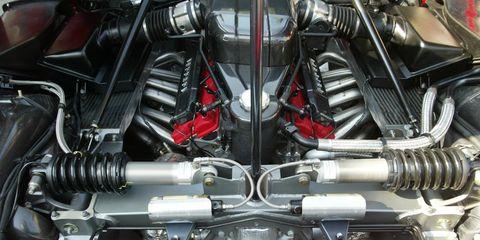 Engine, Automotive engine part, Motorcycle accessories, Metal, Automotive fuel system, Automotive super charger part, Automotive air manifold, Nut, Carbon, Steel,