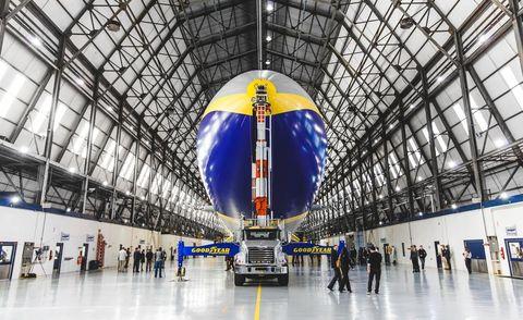 Floor, Engineering, Aerospace engineering, Logo, Fixture, Electric blue, World, Airport, Cobalt blue, Service,