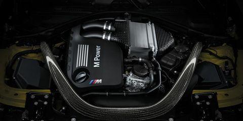 Automotive design, Automotive exterior, Engine, Luxury vehicle, Bumper, Personal luxury car, Automotive engine part, Carbon, Kit car, Machine,