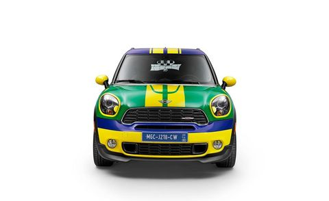 Motor vehicle, Automotive design, Yellow, Vehicle, Grille, Headlamp, Automotive mirror, Hood, Automotive lighting, Car,