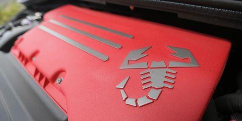 Red, Carmine, Logo, Symbol, Motorcycle accessories, Emblem, Hood,