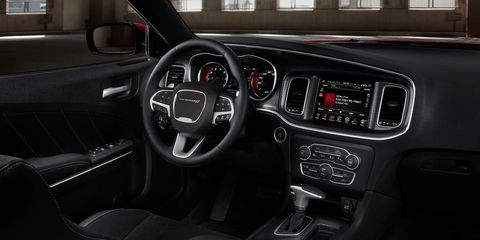 Motor vehicle, Steering part, Steering wheel, Automotive design, Brown, Vehicle, Transport, Center console, Automotive mirror, Vehicle audio,