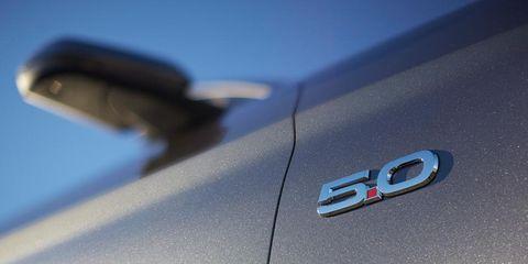 Motor vehicle, Automotive design, Automotive exterior, Logo, Symbol, Emblem, Brand, Automotive door part, Trademark, Silver,