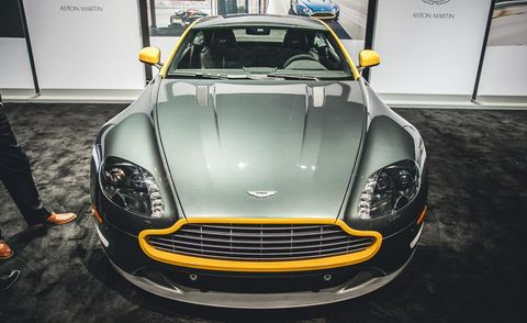 Motor vehicle, Automotive design, Yellow, Vehicle, Headlamp, Hood, Car, Grille, Floor, Fender,
