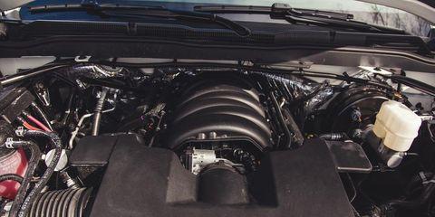 Automotive design, Engine, Automotive exterior, Black, Automotive engine part, Luxury vehicle, Personal luxury car, Hood, Nut, Kit car,