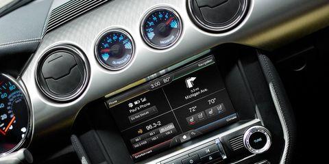 Automotive design, Center console, Vehicle audio, Speedometer, Black, Luxury vehicle, Steering part, Personal luxury car, Gauge, Gear shift,