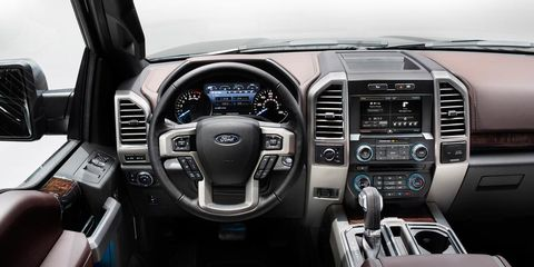 Motor vehicle, Steering part, Product, Automotive design, Brown, Steering wheel, Electronic device, Vehicle audio, Center console, Technology,