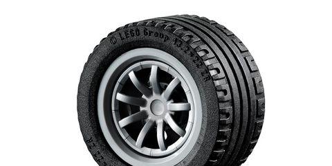 Automotive tire, Product, Rim, Automotive wheel system, White, Synthetic rubber, Tread, Alloy wheel, Carbon, Black,