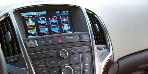 Motor vehicle, Automotive design, Vehicle audio, Center console, Electronic device, Steering part, Technology, Glass, Electronics, Luxury vehicle,