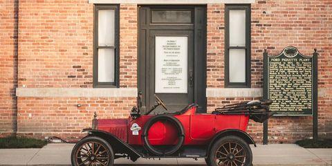 Tire, Mode of transport, Automotive design, Classic car, Brick, Wall, Fender, Road surface, Classic, Antique car,
