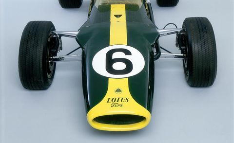 Tire, Automotive tire, Open-wheel car, Automotive design, Yellow, Green, Automotive wheel system, Car, Race car, Logo,