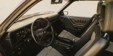 Motor vehicle, Steering part, Mode of transport, Steering wheel, Vehicle door, Classic car, Center console, Car seat, Classic, Windshield,