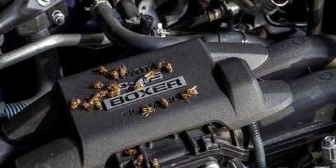 Black, Engine, Automotive engine part, Luxury vehicle, Automotive air manifold, Carbon,