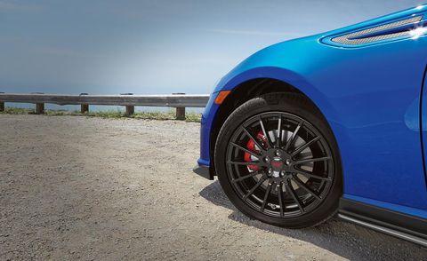 Tire, Wheel, Automotive tire, Blue, Automotive design, Alloy wheel, Rim, Automotive wheel system, Spoke, Automotive exterior,