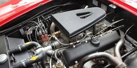 Engine, Automotive engine part, Automotive air manifold, Metal, Automotive super charger part, Hood, Fuel line, Kit car, Nut, Automotive fuel system,