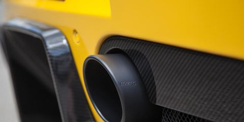 Yellow, Automotive exterior, Composite material, Material property, Carbon, Close-up, Synthetic rubber, Machine, Loudspeaker,
