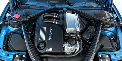 Automotive design, Engine, Automotive exterior, Motorcycle accessories, Automotive engine part, Personal luxury car, Automotive fuel system, Luxury vehicle, Carbon, Automotive air manifold,