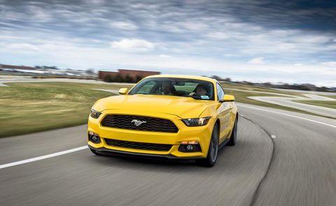 Motor vehicle, Road, Automotive design, Yellow, Vehicle, Hood, Headlamp, Grille, Car, Automotive lighting,