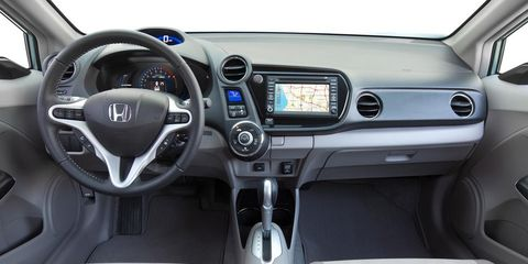 Motor vehicle, Steering part, Mode of transport, Product, Automotive design, Transport, Steering wheel, White, Center console, Technology,