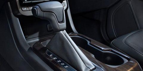 Motor vehicle, Automotive design, Vehicle door, Luxury vehicle, Car seat, Fixture, Center console, Personal luxury car, Gear shift, Carbon,