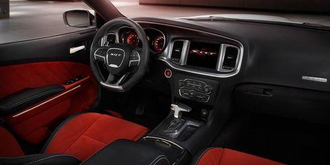 Motor vehicle, Steering part, Steering wheel, Vehicle audio, Center console, Vehicle door, Speedometer, Gauge, Technology, Gear shift,