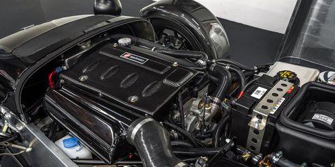 Motor vehicle, Automotive design, Engine, Machine, Personal luxury car, Automotive engine part, Luxury vehicle, Automotive super charger part, Carbon, Kit car,
